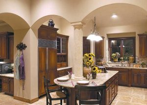The gourmet kitchen of this parade home has a center cooktop island and opens into the formal dining area.