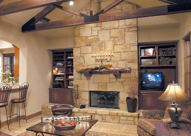 The two main living areas in this parade home are each finished with limestone fireplace surrounds and eye-catching mesquite mantels.