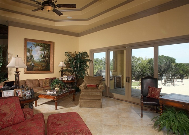 Cordillera Ranch: The spacious living area showcases beautiful travertine floors and tray ceilings.