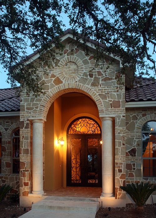 The custom wrought iron front entrance to this Cordillera Ranch stunner welcomes guests and homeowners alike.