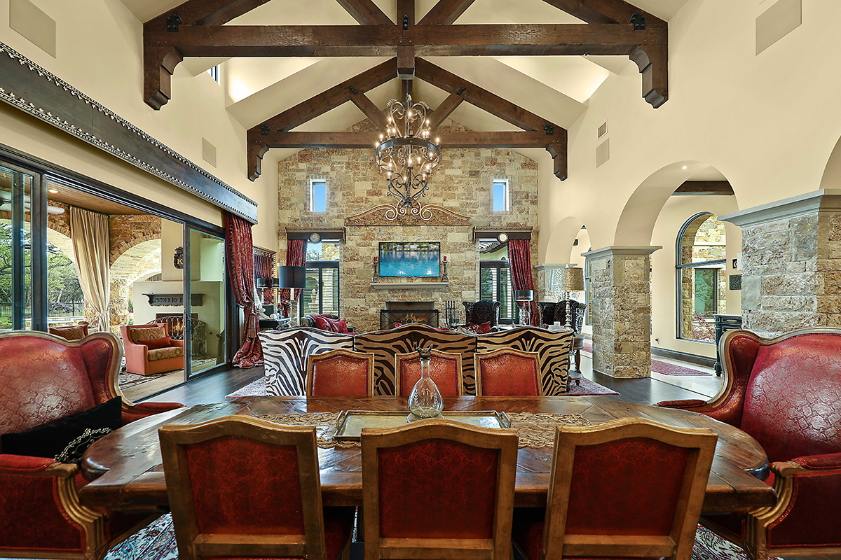 this one story state-of-the-art estate features hill country architecture