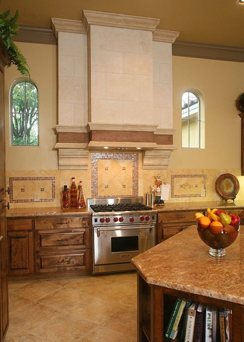 Cordillera Ranch: A custom hood vent and backsplash provide a focal point in the kitchen.