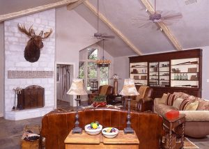 This unbelievable 20+ acre property has been high fenced and stocked with exotic game. Here's a peek into the living area.