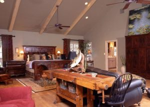 This unbelievable 20+ acre property has been high fenced and stocked with exotic game. The master bedroom is a true hunter's retreat.