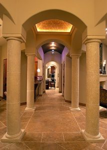 This parade home features a gallery of stone columns reminiscent of old world charm.