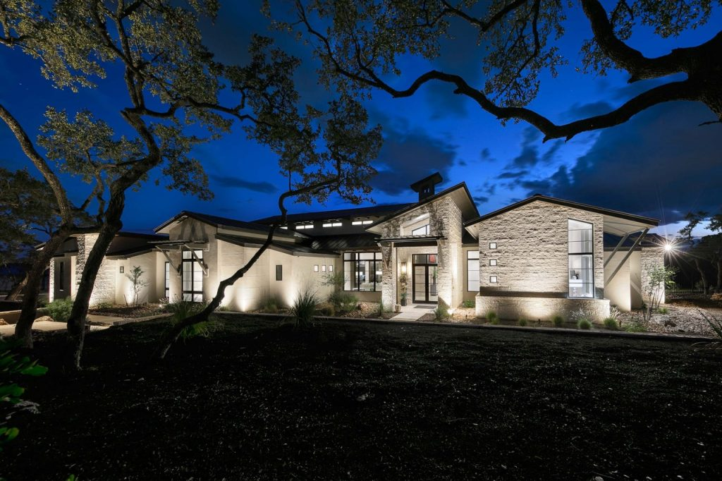 Custom home builder Todd Glowka created an open floorplan with soaring ceilings and massive windows for unobstructed views and light filled rooms in this Stone Creek home