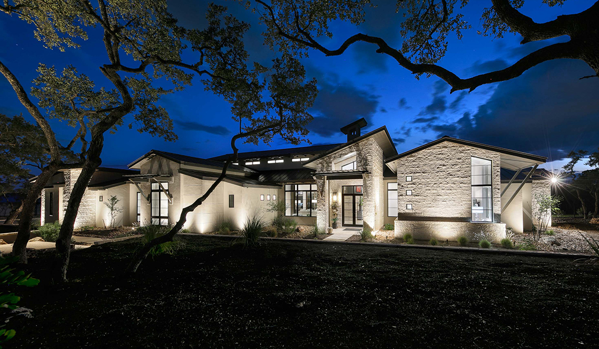Boerne home builder Todd Glowka created an open floorplan with massive windows for unobstructed views and light filled rooms.