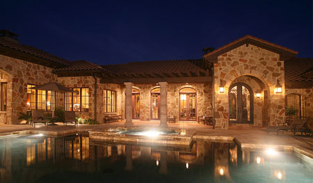 "Anaqua Springs luxury homes such as this 2 acre ""Tejas Espana-styled"" hacienda provide privacy in a relaxed Hill Country setting."